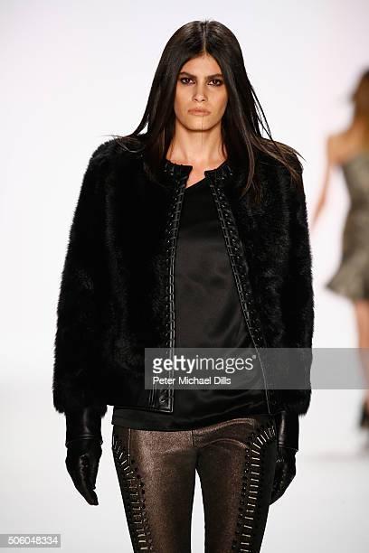 Alisar Ailabouni walks the runway at the Dimitri show during the MercedesBenz Fashion Week Berlin Autumn/Winter 2016 at Brandenburg Gate on January...