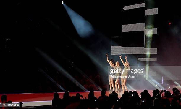 Alisar Hanna and Laura perform during the PRO7 TV show 'Germany's Next Topmodel Final' at the Lanxess Arena on June 10 2010 in Cologne Germany