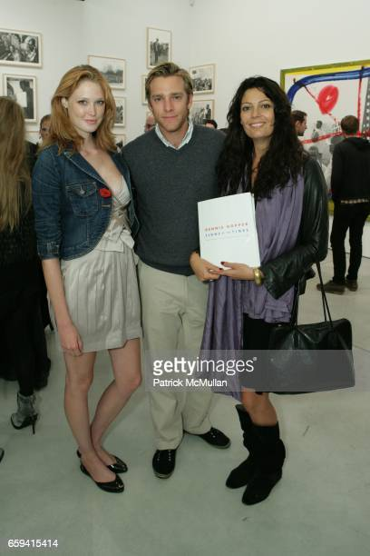 Alise Shoemaker Adam Haggag and Lavia Monovan attend Dennis Hopper's 'Signs of The Times' Opening at the Tony Shafrazi Gallery on September 12 2009...