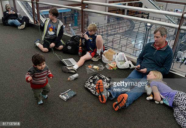Aliseena Juwad 11monthsold waddles past weary travelers during a blizzard shutdown at Denver International Airport March 23 2016 Jawed and family are...