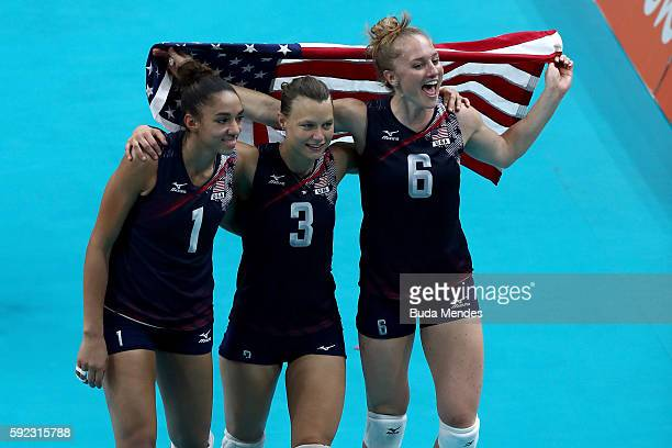 Alisha Glass Courtney Thompson and Carli Lloyd of United States celebrate after winning match point during the Women's Bronze Medal Match between...