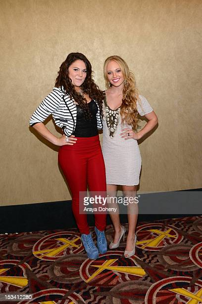 Alisha Mullally and Danielle Chuchran arrive for the sneak preview of '12 Dogs Of Christmas Great Puppy Rescue' at AMC Century City 15 theater on...