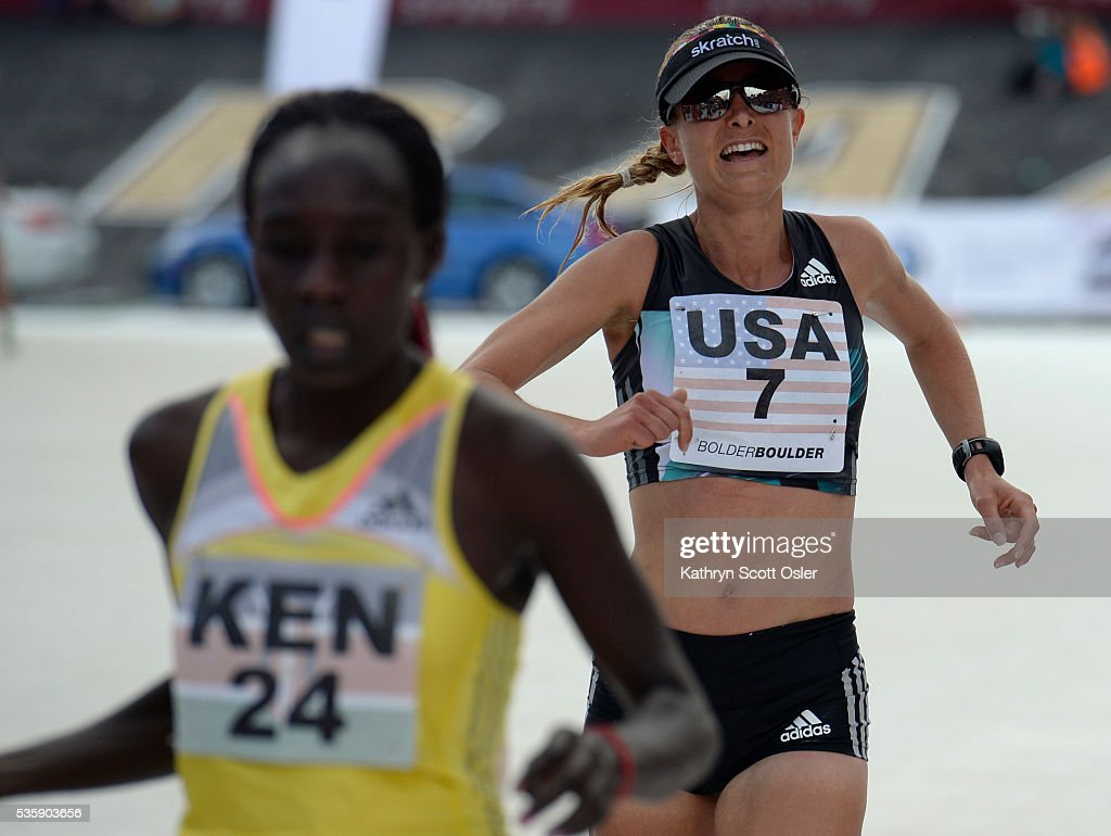 Alisha Williams crosses the finish line for Team USA. The 38th BolderBOULDER takes place along Boulder's streets with the finish line of the 10k race at Folsom Field on the University of Colorado campus on Monday, May 30, 2016.