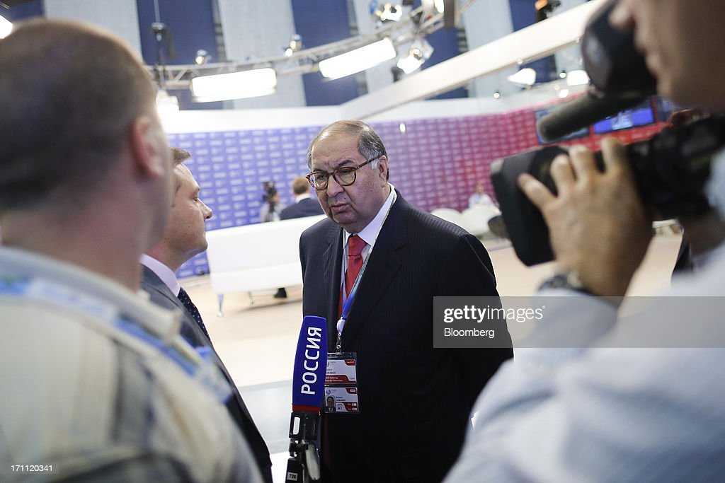 Alisher Usmanov, Russian billionaire and owner of USM Holdings Ltd., speaks to a Russian television crew on day two of the St. Petersburg International Economic Forum 2013 (SPIEF) in St. Petersburg, Russia, on Friday, June 21, 2013. President Vladimir Putin is battling investor skepticism to woo foreign executives descending on his hometown today as Russia's economy faces a risk of recession and a crackdown on critics scares off intellectuals. Photographer: Simon Dawson/Bloomberg via Getty Images