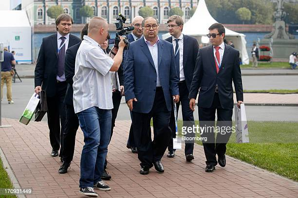 Alisher Usmanov Russian billionaire owner of USM Holdings Ltd center leaves with his entourage following a Bloomberg Television interview on the...