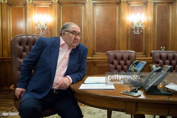 Alisher Usmanov Russian billionaire pauses during an interview at his office in Moscow Russia on Thursday April 6 2017 Arsenals secondbiggest...