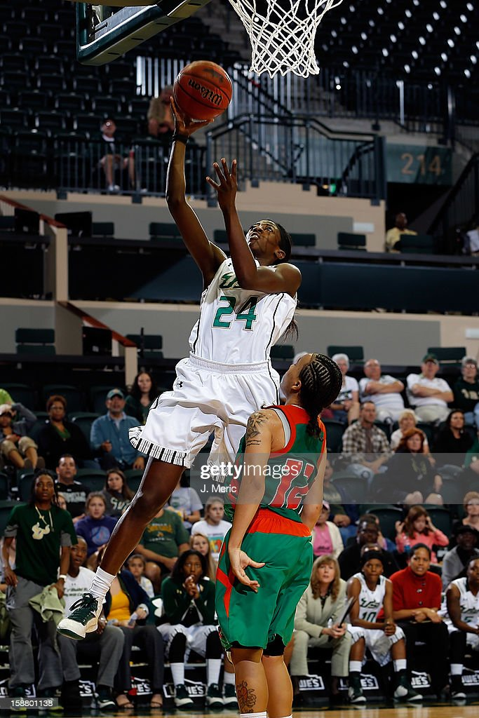 Alisia Jenkins #24 of the South Florida Bulls drives to the basket as Kimberly Sparkman #12 of the Florida A&M Rattlers defends during the game at the Sun Dome on December 29, 2012 in Tampa, Florida.