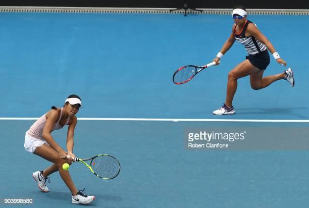 Alison Bai of Australia returs a shot as Lizette Cabrera of Australia looks on during their doubles semi finals match againsts Lyudmyla Kichenok of...