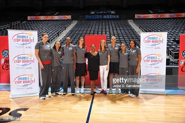 Alison Bales Armintie Price Sancho Lyttle of the Atlanta Dream former player Kayte Christensen WNBA President Laurel Richie Owner Kelly Loeffler...
