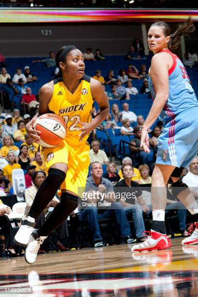 Alison Bales of the Atlanta Dream watches as Ivory Latta of the Tulsa Shock drives to the inside during the WNBA game on July 26 2011 at the BOK...