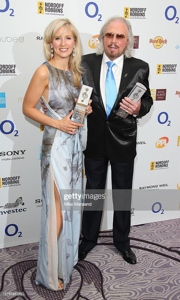 Alison Balsom and Barry Gibb attend the Nordoff Robbins Silver Clef Awards at London Hilton on June 28, 2013 in London, England.