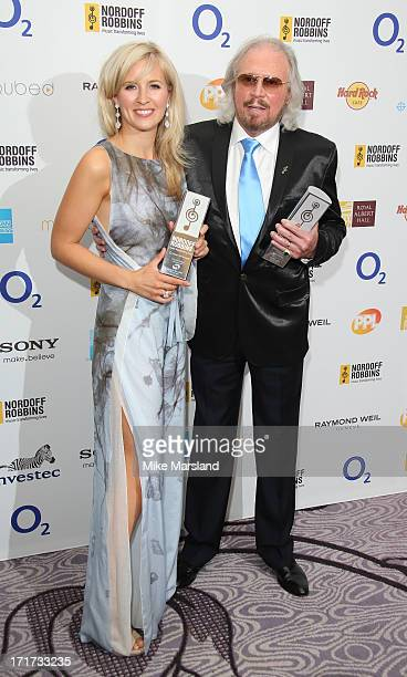 Alison Balsom and Barry Gibb attend the Nordoff Robbins Silver Clef Awards at London Hilton on June 28 2013 in London England