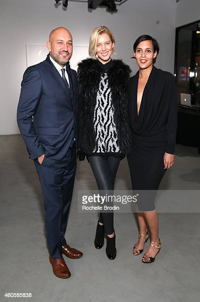 Alison Bignon Taylor Reynolds and Steph Sebbag attend the Fragments exhibition at De Re Gallery on December 16 2014 in West Hollywood California