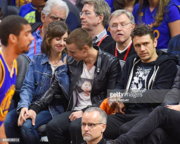 Alison Brie Dave Franco and James Franco attend a basketball game between the Golden State Warriors and Los Angeles Clippers at Staples Center on...