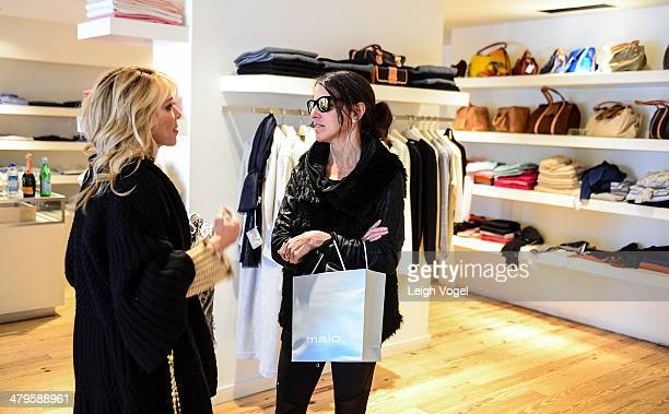 Alison Brod and Joey May visit the Malo store during DuJour's Haley and Jason Binn and Marcy Warren Welcome Malo's John Wilson in Aspen at The Little...
