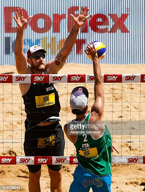 Alison Ceruti of Brazil blocks the ball against Daniele Lupo of Italy during the final match at Camburi beach during day six of the FIVB Beach...
