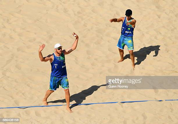 Alison Cerutti and Bruno Oscar Schmidt of Brazil celebrate a point during the Men's Beach Volleyball preliminary round Pool A match against Josh...