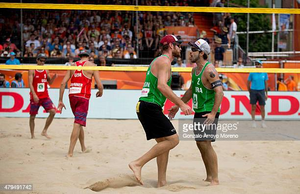 Alison Cerutti from Brazil celebrates with his teammate Bruno Oscar Schmidt during the FIVB Beach Volleyball World Championships Male Semifinal Match...