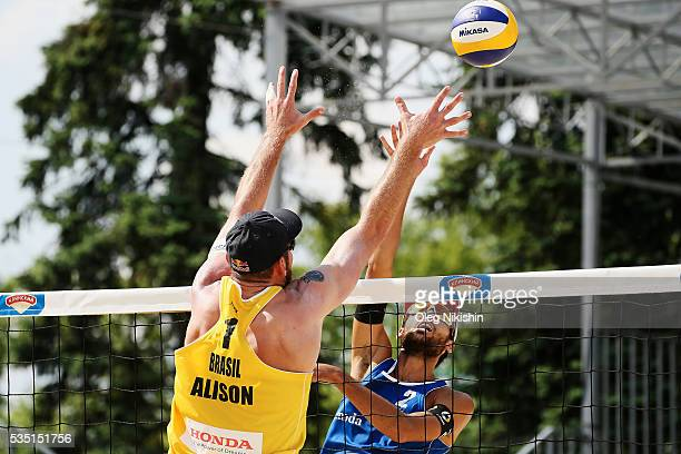 Alison Cerutti of Brazil and Daniele Lupo of Italy duel at the net during a game between Brazil and Italy on day 5 of the FIVB Moscow Grand Slam at...