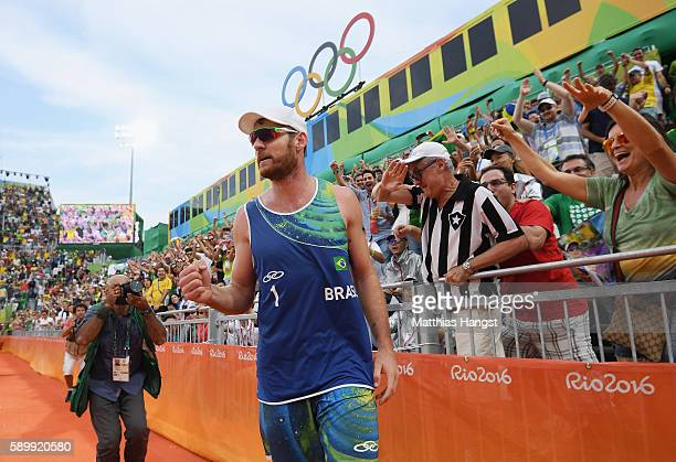 Alison Cerutti of Brazil celebrates after winning match point in the Men's Beach Volleyball Quarterfinal match against Phil Dalhausser and Nicholas...