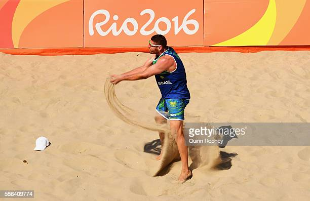 Alison Cerutti of Brazil celebrates during the Men's Beach Volleyball preliminary round Pool A match against Josh Binstock and Samuel Schachter of...