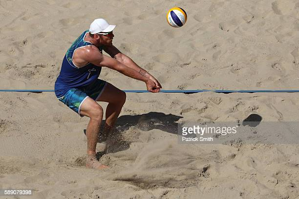 Alison Cerutti of Brazil sets the ball during a Men's Round of 16 match between Spain and Brazil on Day 8 of the Rio 2016 Olympic Games at the Beach...