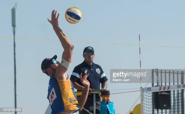 Alison Conte Cerutti of Brazil competes during match im the men's round of 16 between Predo Solberg Salgado of Brazil and Bruno Oscar Schmidt of...