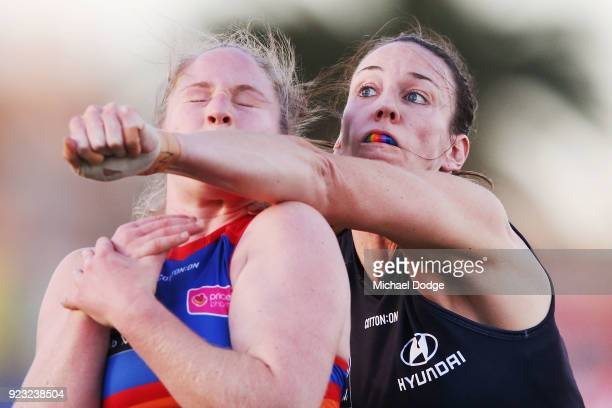 Alison Downie of the Blues punches Aasta O'Connor of the Bulldogs during the round four AFLW match between the Western Bulldogs and the Carlton Blues...