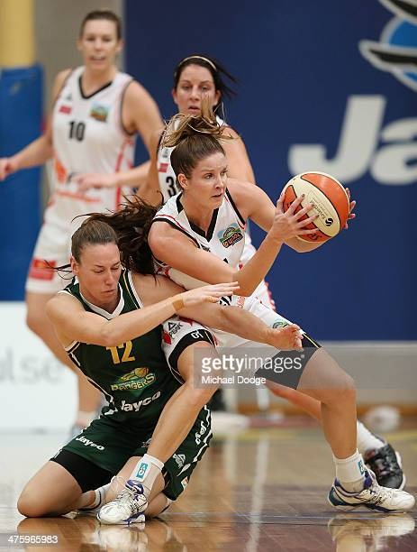 Alison Downie of the Ranges and Stephanie Cumming of the Fire contest for the ball during the WNBL Preliminary Final match between the Dandenong...