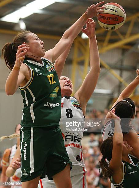 Alison Downie of the Ranges and Suzy Batkovic of the Fire contest for the ball during the WNBL Preliminary Final match between the Dandenong Rangers...