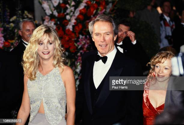 Alison Eastwood, Clint Eastwood, and Frances Fisher arrive at the 66th Annual Academy Awards March 21, 1994 at the Dorothy Chandler Pavilion, Los...