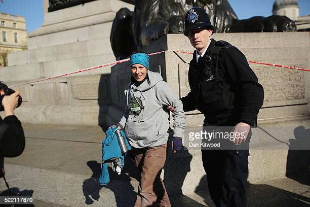Alison Garrigan a greenpeace activist is arrested after abseiling down Nelson's column on the statue on April 18 2016 in London England The...