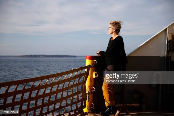 Alison Goodwin of Peaks Island enjoys the warm breeze from the stern of the Machigonne II ferry Goodwin described the recordsetting weather in two...