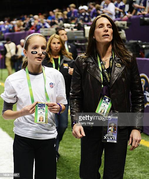 Alison Harbaugh and Ingrid Harbaugh daughter and wife of Baltimore Ravens head coach John Harbaugh stand on the field prior to Super Bowl XLVII...