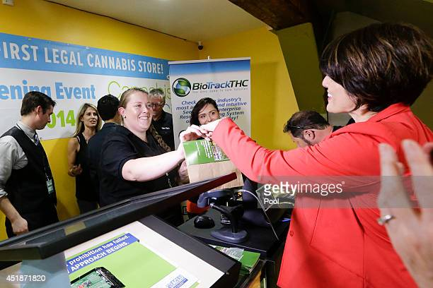 Alison Holcomb criminal justice director at the Washington state ACLU buys marijuana at the Cannabis City retail marijuana store on July 8 2014 in...