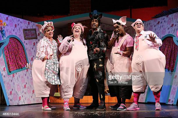 Alison Jiear Leanne Jones Simon Webbe Taofique Folarin and Daniel Buckley perform on stage during a photocall for The Three Little Pigs at Palace...