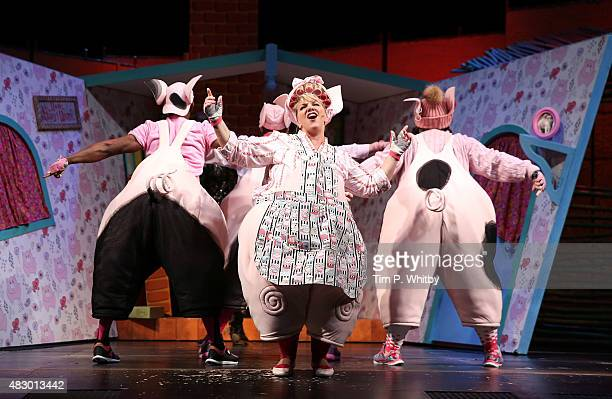 Alison Jiear performs on stage during a photocall for The Three Little Pigs at Palace Theatre on August 5 2015 in London England