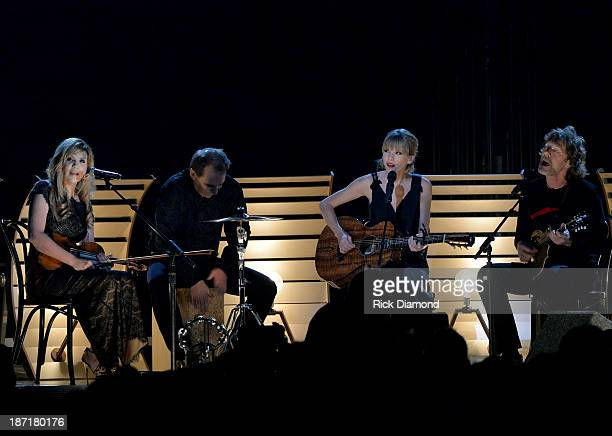 Alison Krauss Eric Darken Taylor Swift and Sam Bush perform onstage during the 47th annual CMA Awards at the Bridgestone Arena on November 6 2013 in...