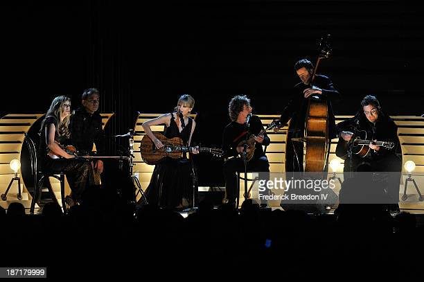 Alison Krauss Eric Darken Taylor Swift Sam Bush Edger Miller and Vince Gill perform during the 47th annual CMA awards at the Bridgestone Arena on...