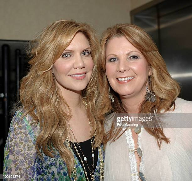 Alison Krauss Patty Loveless backstage during the Music Saves Mountains benefit concert at the Ryman Auditorium on May 19 2010 in Nashville Tennessee