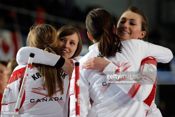 Alison Kreviazuk, Rachel Homan, Lisa Weagle and Emma Miskew of Canada celebrate winning the Bronze medal match between USA and Canada on Day 9 of the...