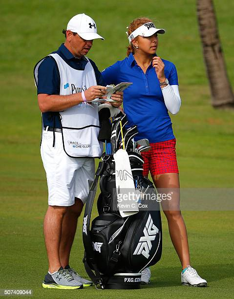 Alison Lee discusses her shot with her caddie on the seventh hole during the second round of the Pure Silk Bahamas LPGA Classic at the Ocean Club...