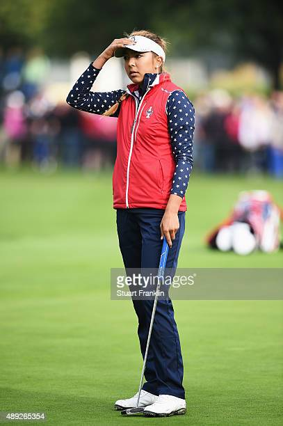 Alison Lee of team USA reacts after missing her putt on the 17th green shortly afterwards she was told that her short putt had not been conceeded and...