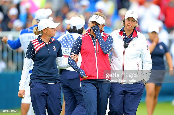 Alison Lee of the United States is comforted by Wendy Ward United States assistant captain and Stacy Lewis on the 18th green after Lee's error in...
