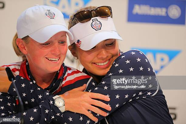 Alison Lee of the United States Team hugs her teammate Stacy Lewis at the press conference after the 2015 Solheim Cup at St LeonRot Golf Club on...