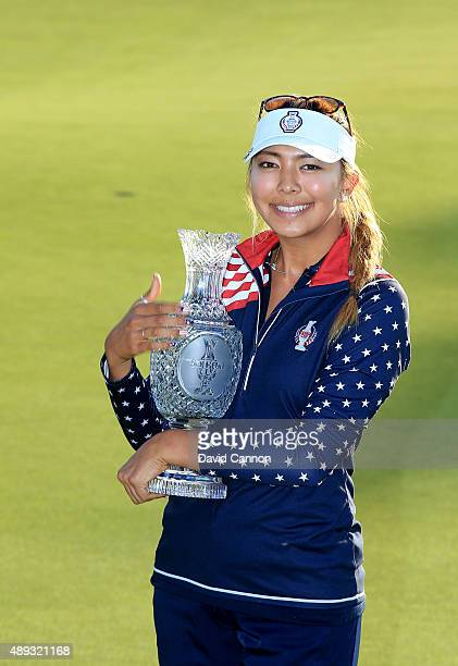 Alison Lee of the United States Team proudly holds the Solheim Cup trophy after the closing ceremony during the final day singles matches in the 2015...