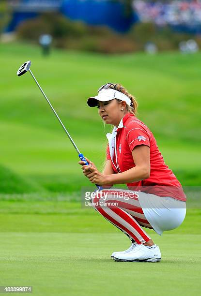 Alison Lee of the United States team reacts as a birdie putt misses on the 9th green in her match with Angela Stanford against Gwladys Nocera and...
