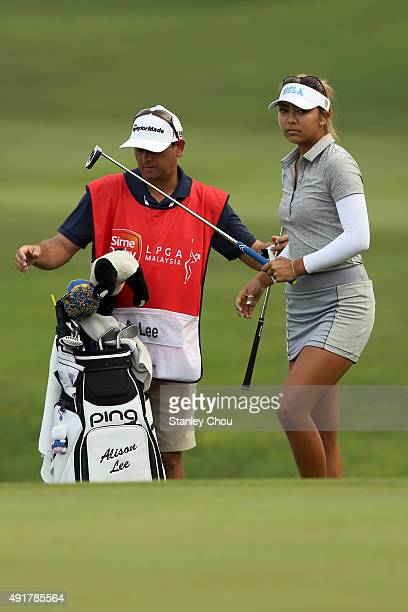 Alison Lee of USA prepares to play on the 18th hole during round one of the Sime Darby LPGA Tour at Kuala Lumpur Golf Country Club on October 8 2015...
