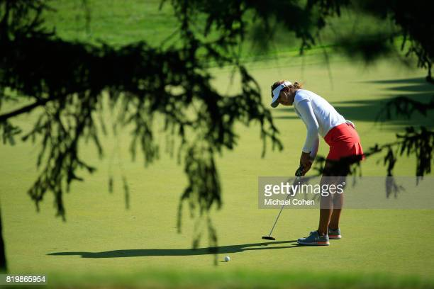 Alison Lee Strokes a putt for birdie on the eighth green during the first round of the Marathon Classic Presented By Owens Corning And OI held at...