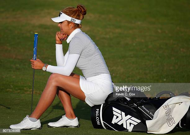 Alison Lee waits to putt on the eighth green during the first round of the Pure Silk Bahamas LPGA Classic at the Ocean Club Golf Course on January 28...